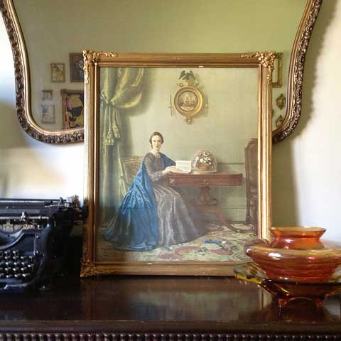 gold framed vintage lady