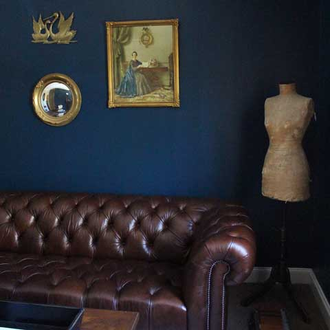 parlour gold wall decor hung on dark walls